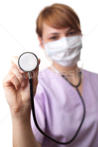 Female doctor holding stethoscope pointed toward camera 2 Stock photo © ra2studio