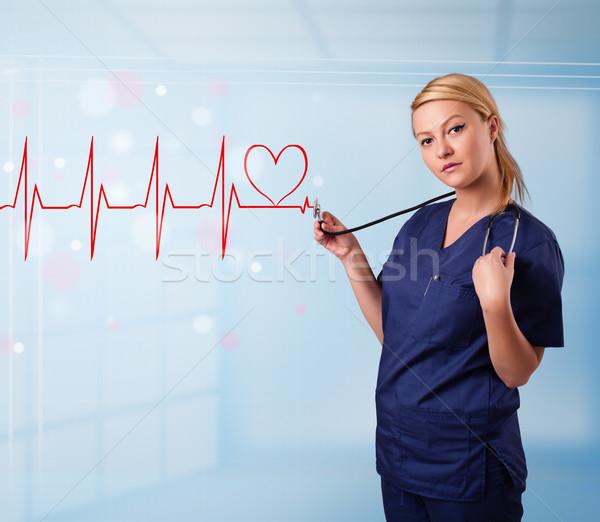 Jeunes infirmière écouter résumé impulsion rouge Photo stock © ra2studio