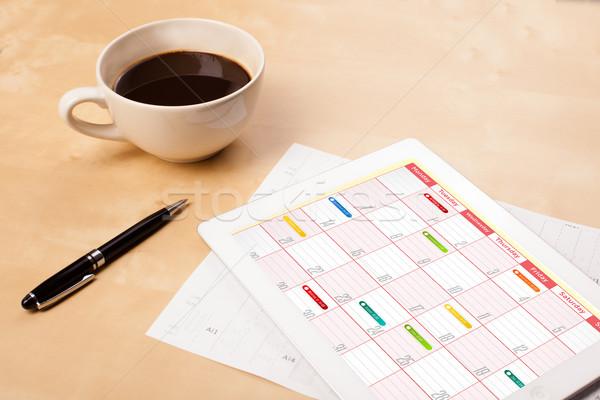 Travail calendrier tasse café Photo stock © ra2studio