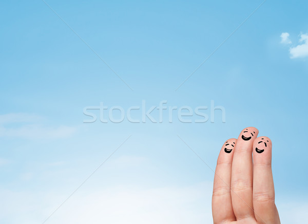 Happy smiley fingers looking at clear blue sky copyspace Stock photo © ra2studio
