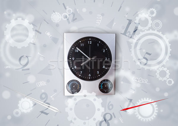 Modern clock with parts comming out Stock photo © ra2studio