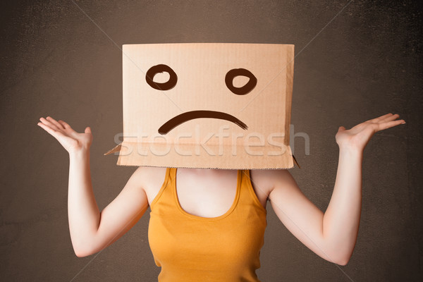 Joven marrón caja de cartón cabeza pie Foto stock © ra2studio