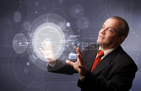 Işadamı dokunmak soyut yüksek teknoloji düğmeler Stok fotoğraf © ra2studio