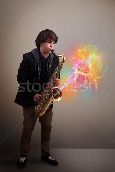 Séduisant musicien jouer saxophone coloré résumé Photo stock © ra2studio
