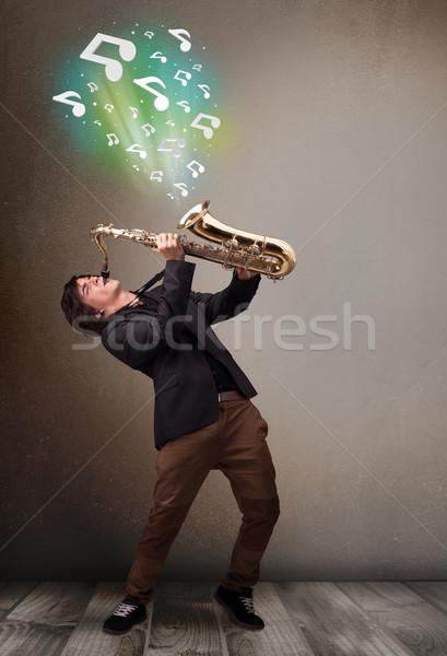 小さな ミュージシャン 演奏 サクソフォン 音符 魅力的な ストックフォト © ra2studio