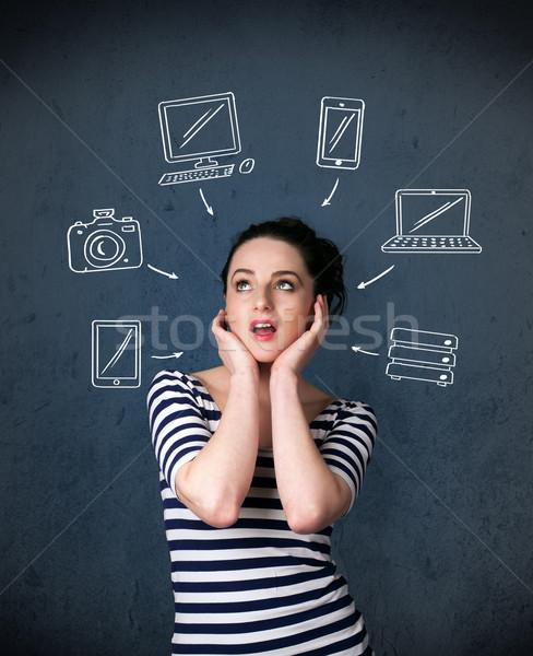 Jonge vrouw denken gadgets rond hoofd Stockfoto © ra2studio