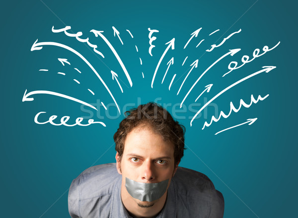 Young man with glued mouth and lines, arrows Stock photo © ra2studio