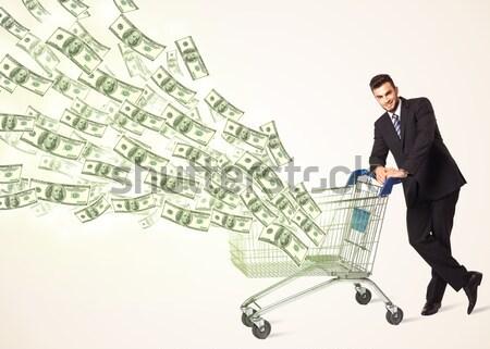 Zakenman winkelwagen voortvarend uit business Stockfoto © ra2studio