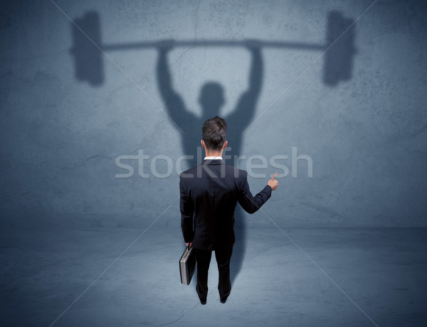 üzletember súlyemelés árnyék fiatal elegáns eladó Stock fotó © ra2studio