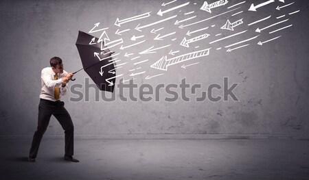 Iş adamı ayakta şemsiye oklar iş Stok fotoğraf © ra2studio