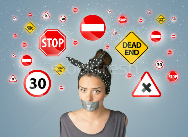 Stock photo: Young woman with glued mouth and traffic signals