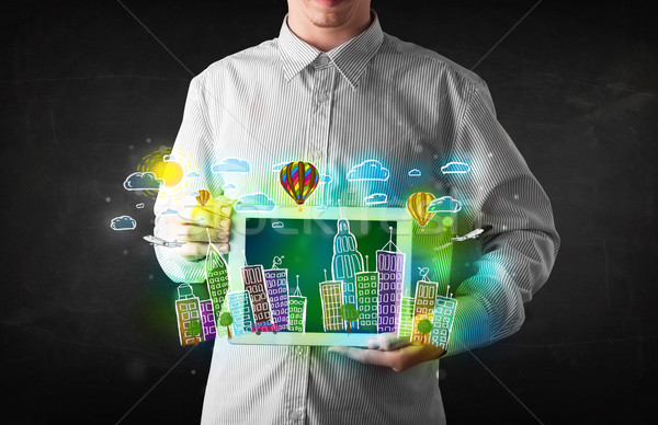Stock photo: Young person showing tablet with hand drawn cityscape