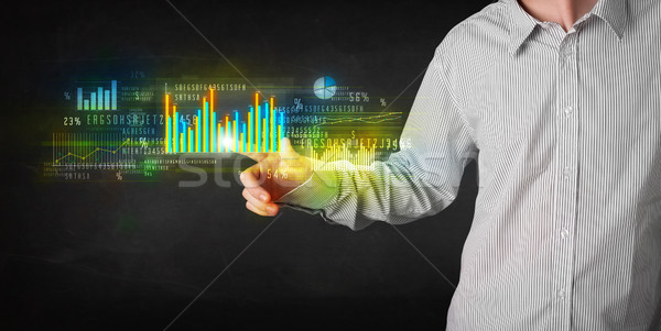 Young business person touching colorful charts and diagrams Stock photo © ra2studio