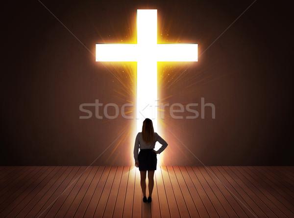 Woman looking at bright cross sign  Stock photo © ra2studio