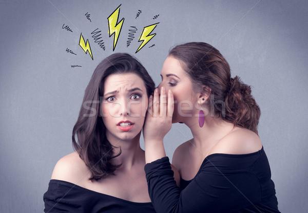 girl telling secret things to her girlfriend Stock photo © ra2studio