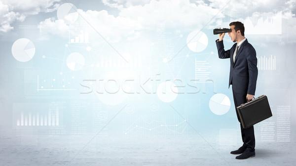 Businessman  looking forward with binoculars Stock photo © ra2studio