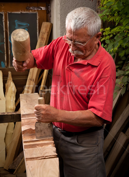 woodcarver working with mallet and chisel 2 Stock photo © ra2studio