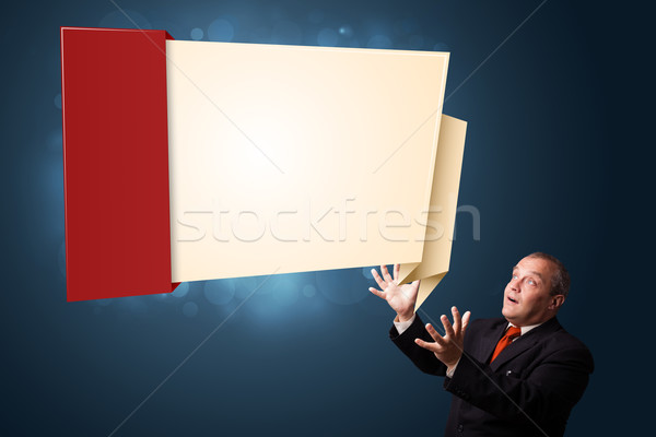 funny businessman presenting modern origami copy space Stock photo © ra2studio