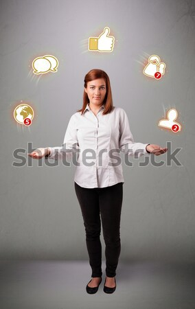 Fiatal hölgy áll zsonglőrködés valuta ikonok Stock fotó © ra2studio
