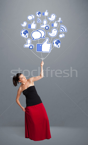 Stock fotó: Csinos · nő · tart · társasági · ikon · léggömb · fiatal