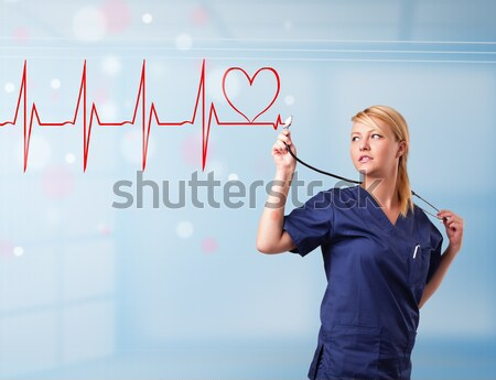 Young nurse listening to abstract pulse with red heart Stock photo © ra2studio