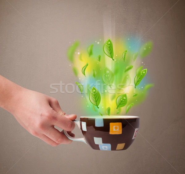 Tea cup with leaves and colorful abstract lights Stock photo © ra2studio