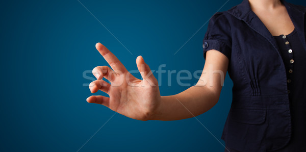 Woman pressing imaginary button Stock photo © ra2studio