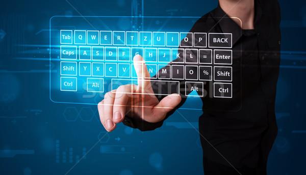 Empresário virtual tipo teclado jovem Foto stock © ra2studio