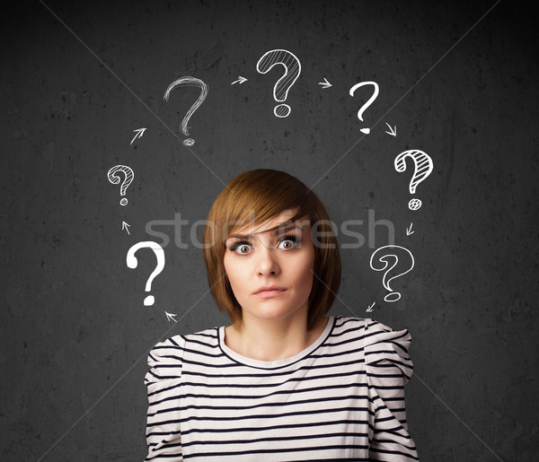 Młoda kobieta myślenia znak zapytania około zamyślony Zdjęcia stock © ra2studio