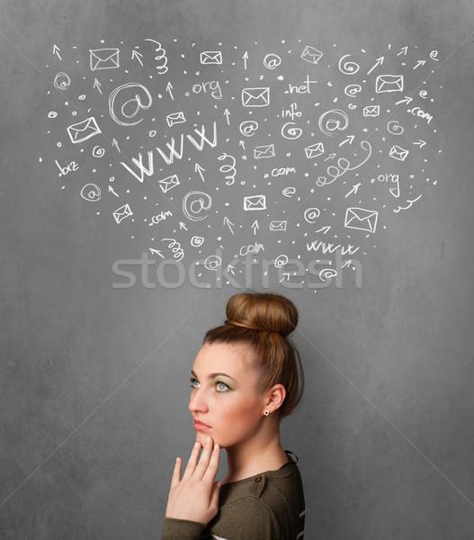 Fiatal nő gondolkodik közösségi háló ikonok fölött fej Stock fotó © ra2studio
