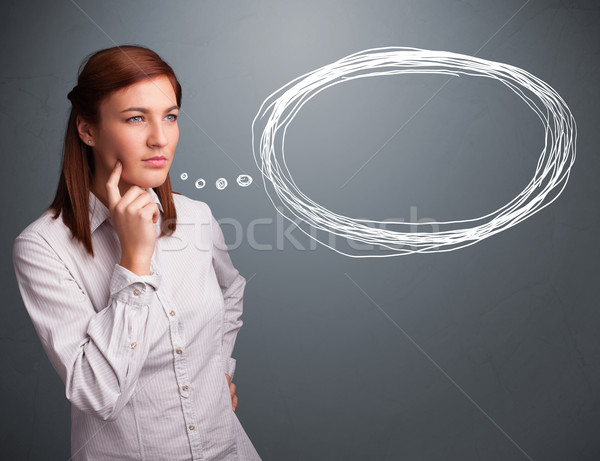 Young lady thinking about speech or thought bubble with copy spa Stock photo © ra2studio