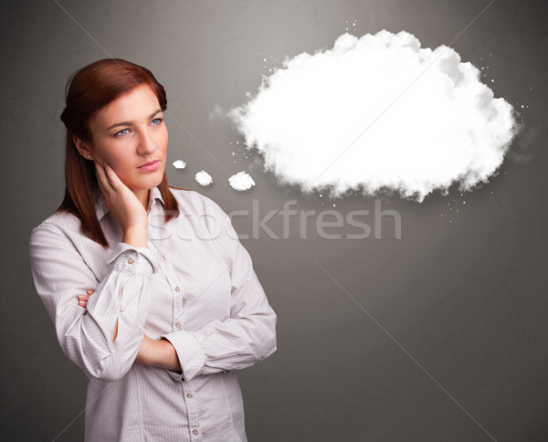 Pretty lady thinking about cloud speech or thought bubble with c Stock photo © ra2studio