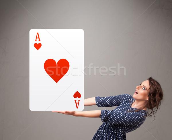 Donna rosso cuore ace Foto d'archivio © ra2studio
