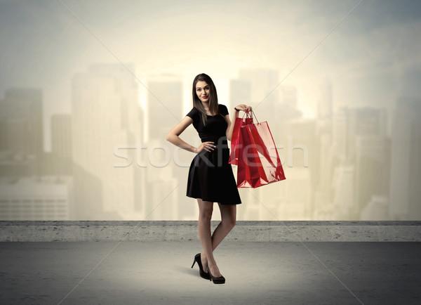 市 女性 立って ショッピングバッグ 魅力的な 女性 ストックフォト © ra2studio