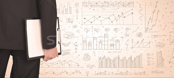 Businessman with diagrams and graphs Stock photo © ra2studio