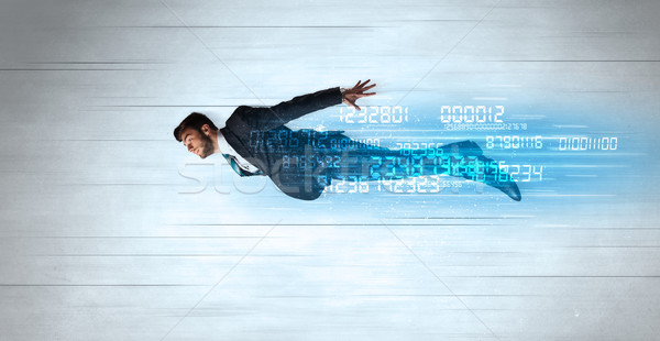Businessman flying super fast with data numbers left behind Stock photo © ra2studio