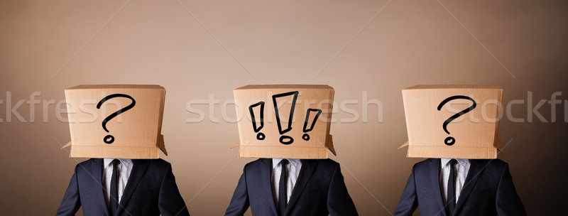 Men gesturing with exclamation marks on box on their head Stock photo © ra2studio