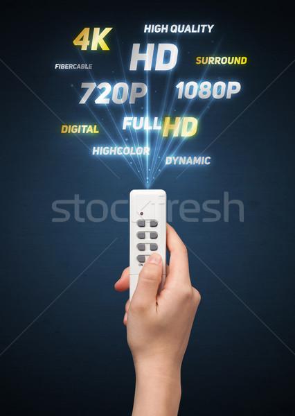 Main télécommande multimédia sur technologie Photo stock © ra2studio