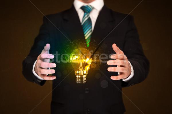 Foto stock: Empresario · bombilla · brillante · cuerpo · mano