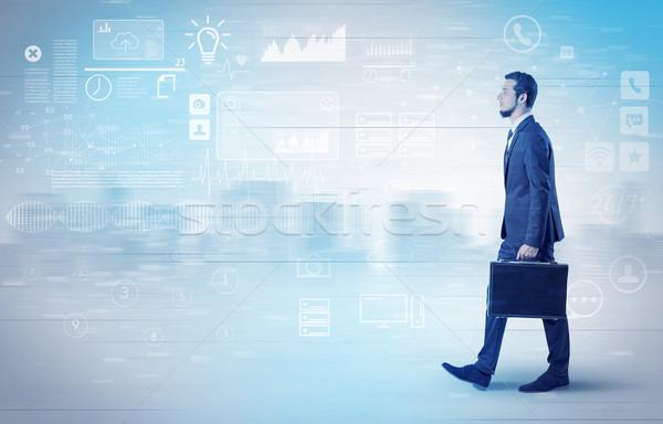 Biznesmen spaceru bazy danych około przystojny garnitur Zdjęcia stock © ra2studio