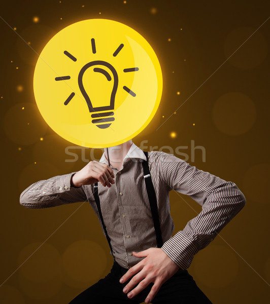 Businessman holding lightbulb sign Stock photo © ra2studio