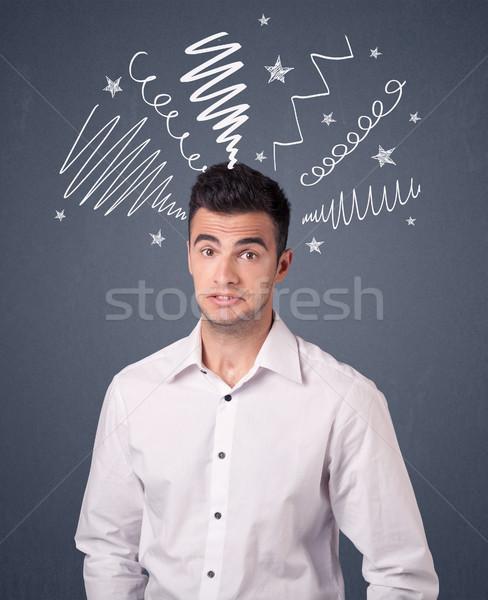 Businessman with scribbles Stock photo © ra2studio