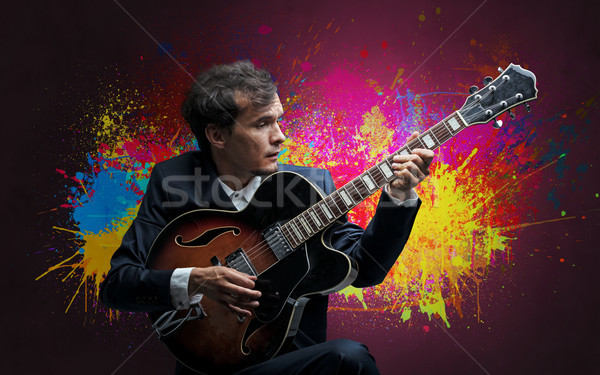 Composer with splotch and his guitar Stock photo © ra2studio