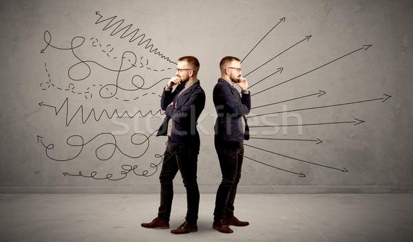 бизнесмен два молодые инструкция Сток-фото © ra2studio