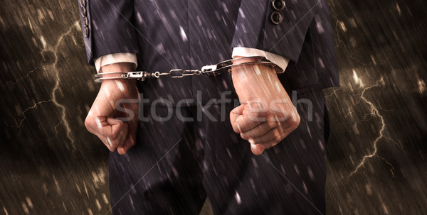 Stormy wallpaper with close handcuffed man Stock photo © ra2studio
