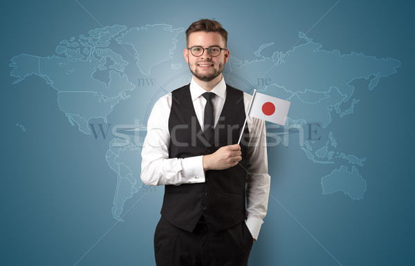 Man standing with flag and map background Stock photo © ra2studio