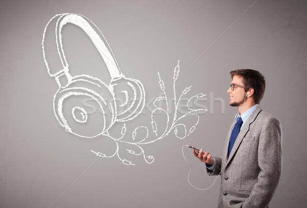 attractive man singing and listening to music with abstract headphone Stock photo © ra2studio