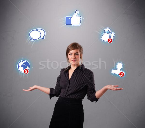 Vonzó fiatal nő zsonglőrködés közösségi háló ikonok áll Stock fotó © ra2studio