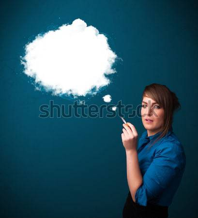 Young woman smoking unhealthy cigarette with dense smoke Stock photo © ra2studio