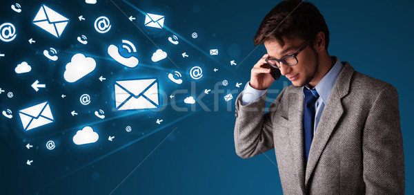 Young man making phone call with message icons Stock photo © ra2studio